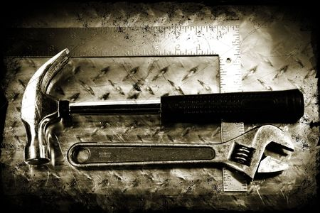 Work tools on a grunge metal background photo