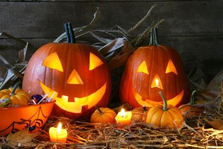 halloween pumpkins: Carved jack-o-lanterns lit for halloween