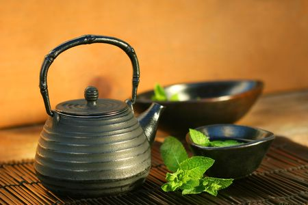Japanese teapot and cup with mint tea