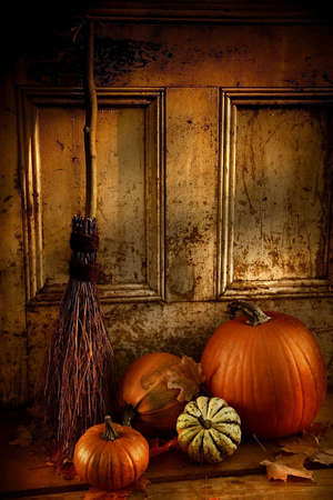 gourds:  night Pumpkins, broom and gourds at the door ready for
