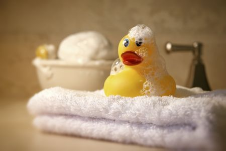 rubber ducky: Bath time with soap and rubber ducky Stock Photo