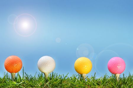 golfing: Colored golf balls in the grass