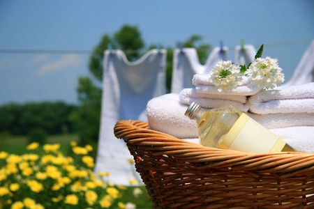 basket: Clean towels freshly folded in wicker basket