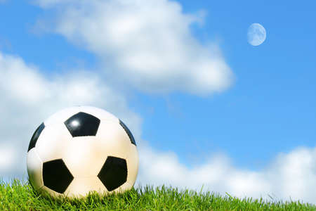 Soccer ball against a blue sky photo