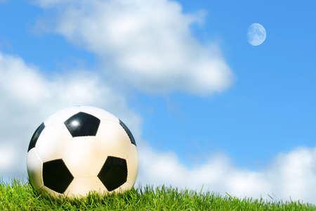 Soccer ball against a blue sky photo
