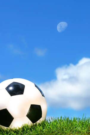 Closeup of a soccer ball against a blue sky photo