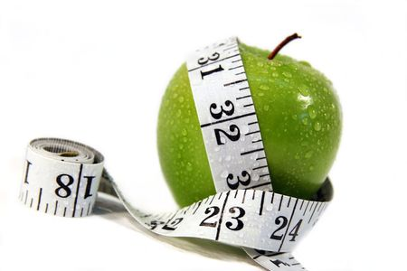 measurement tape: Measurement tape wrapped around green appleConcept for health, diet