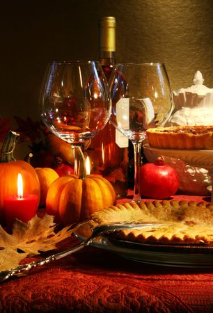 Table elegantly set with wine  for Thanksgiving photo