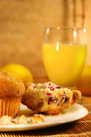 Healthy breakfast with cranberry muffins and orange juice on bamboo mat Stock Photo - 2575311