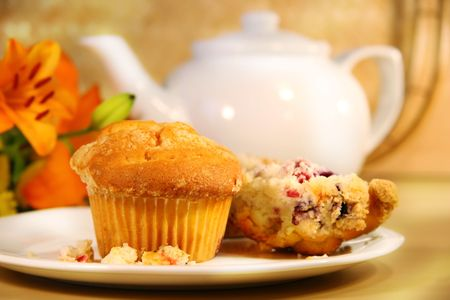 Breakfast with cranberry muffins, teapot and orange juice on bamboo mat Stock Photo - 2575314