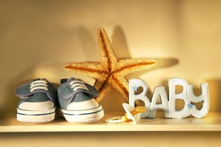 shoes place on a shelf with  pacifier, starfish etc..