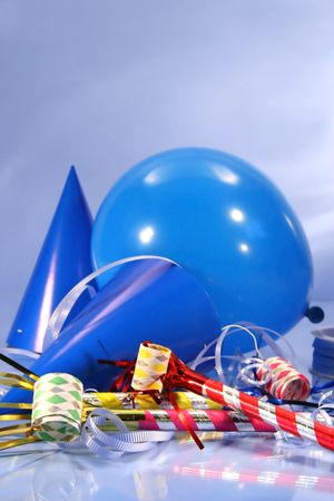 Party decorations with hats, ribbons and balloons photo