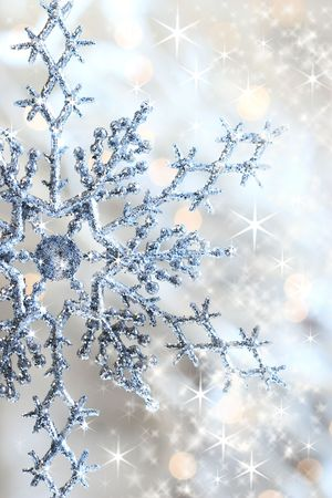 crystal background: Closeup of snowflake with shimmering lights in background Stock Photo
