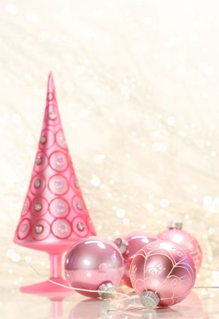 silver background: Pink holiday tree with glass balls and simmering background