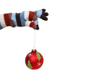 Winter mitten holding a Christmas ball Stock Photo
