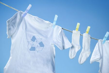 laundered: Eco- friendly  laundry drying on clothes line against a blue sky