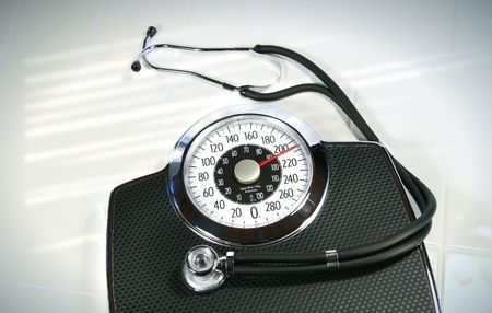 stethoscope: Weight scale with stethoscope on white tile