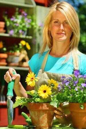 Attractive woman doing work in her garden