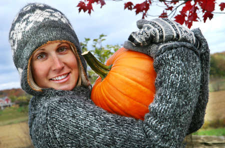 Gathering pumpkins for Thanksgiving holiday festivities photo