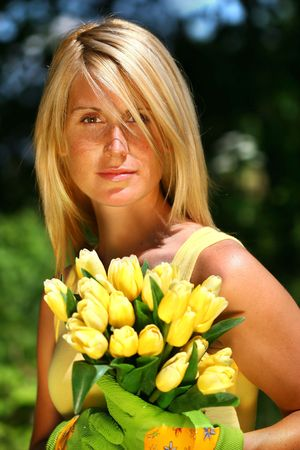 Pretty woman holding tulips photo