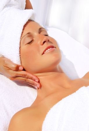 facial muscles: Pretty woman receiving massage at a outdoor spa Stock Photo