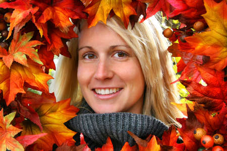Woman smiling with leaves around her photo