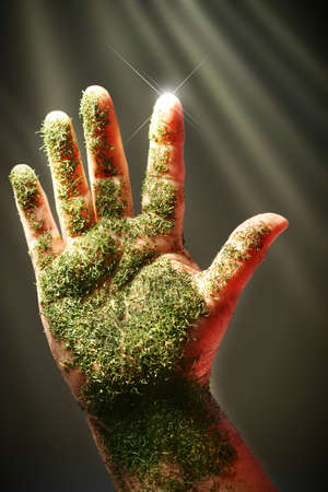 Open hand with green substance against dark background Stock Photo - 2834117