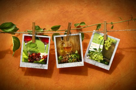 Pictures with vine pinned on clothesline against rustic background Фото со стока