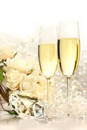 festivities: Champagne glasses ready for  festivities with roses