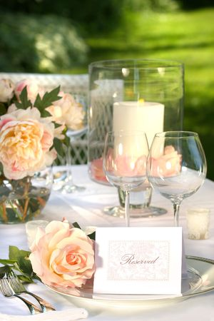 plate setting: Place setting and card on a table at a wedding reception
