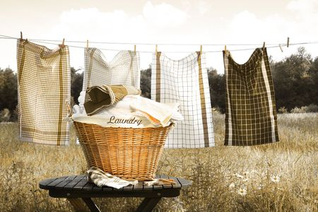 Towels drying on the clothesline with laundry basket Sepia tone photo