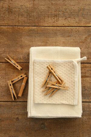 Cotton dish towel with clothes pins on antique table