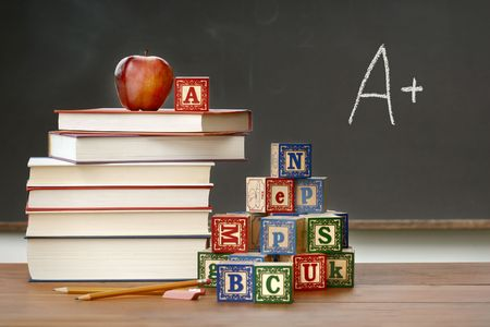 Pile of books with wooden blocks in front of chalkboard Stock Photo - 3386032