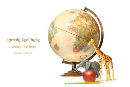 World globe with toy animals and apple on white background photo