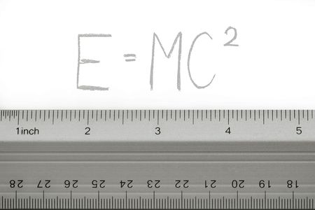 School metal ruler on white background