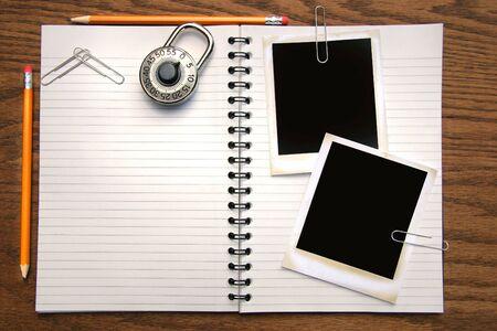 white polaroids: White copy book, pencils and polaroids on oak surface Stock Photo