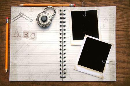 White copy book, pencils and polaroids on oak surface Stock Photo - 3500572