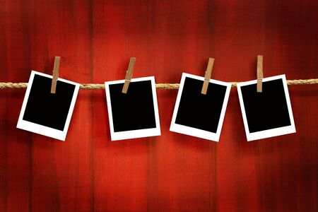 Photos frames on rustic red wood background Stock Photo - 3733935