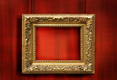 Red wood background with antique gold frame Stock Photo - 3733950
