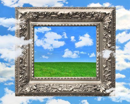 ふくらんでいる雲と青空銀額縁 写真素材