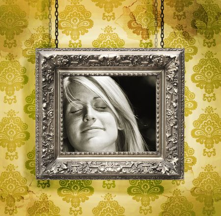 hung: Picture frame hung against floral wallpaper backgroundyellow