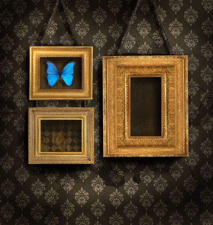 Three gilded frames on antique wallpaper background photo