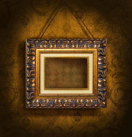 grunge background: Gold picture frame on antique wallpaper background