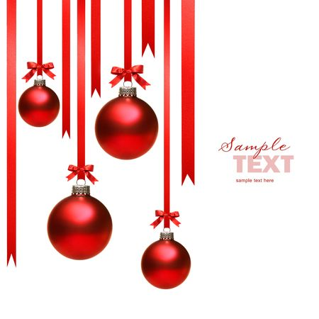 christmas decor: Christmas balls hanging with ribbons on white background