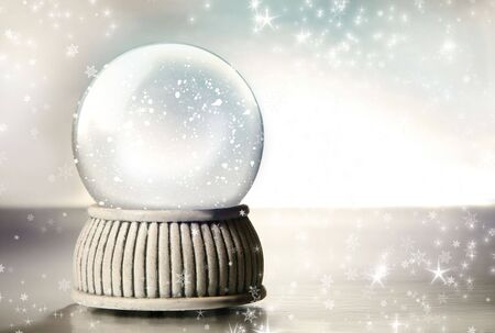 christmas decorations with white background: Snow globe against a silver background Stock Photo