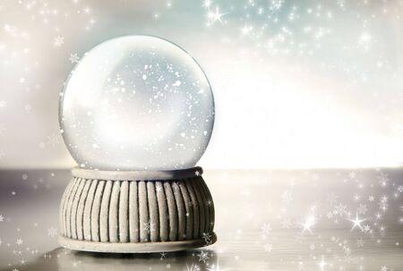 Snow globe against a silver background 免版税图像