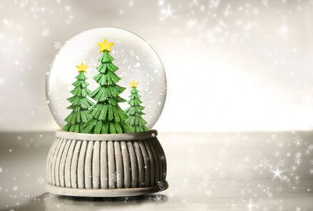 Snow globe against a silver background photo