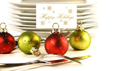 Closeup of christmas place card holders with plates and utensils Banco de Imagens