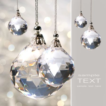 crystal background: Crystal ornament hanging against shimmering background Stock Photo