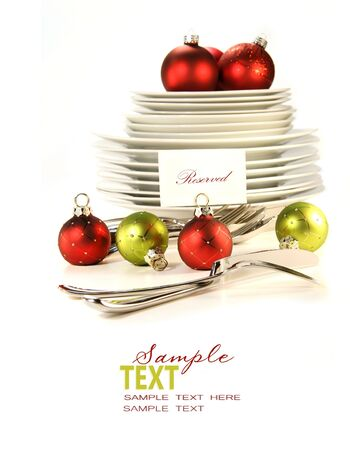 Festive place card holders with plates and cutlery on white background